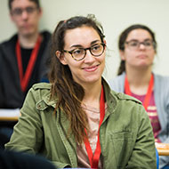 A young women smiles in class